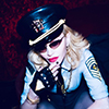 Madonna celebrating her 61st birthday, dressed up as a general. Photo by Ricardo Gomes.